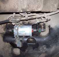 Где топливный фильтр рено логан 1 6 8 клапанов